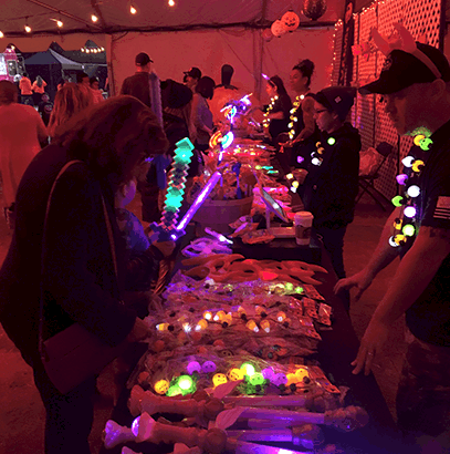 People shopping at the Nights of the Jack Souvenir Shop